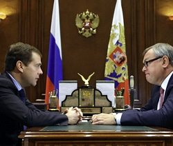 MEETING: Russia's President Medvedev is briefed on the concept of mobile contactless payments by Andrei Kostin, head of the country's largest bank