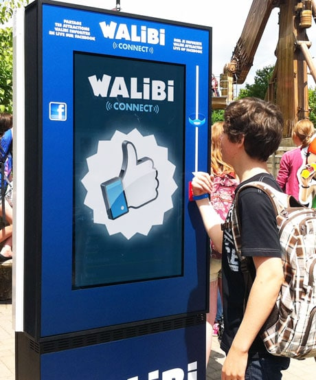 Theme park visitors 'like' rides on Facebook by touching a contactless bracelet to a Walibi 'Totem'
