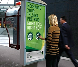 Telstra's NFC phone booth ad campaign in action