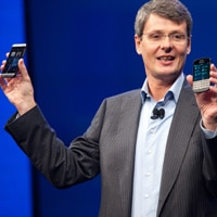 BlackBerry president and CEO Thorsten Hines presents the new devices