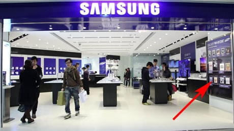 The pop-up poster sits at the front of the Samsung store