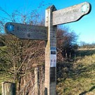 An NFC tag on a signpost on the South Downs