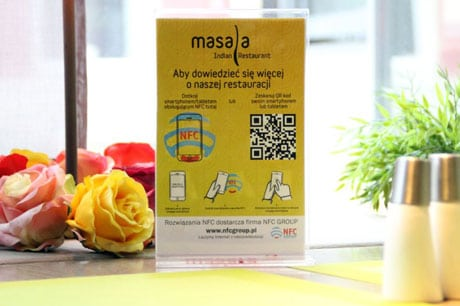 An NFC table tent at the Masala Bar & Grill in Wroclaw, Poland