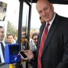 CEO Sureyya Ciliv boards a bus with Turkcell Wallet