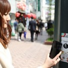 Tapping an NFC tag in Tokyo's Shibuya district