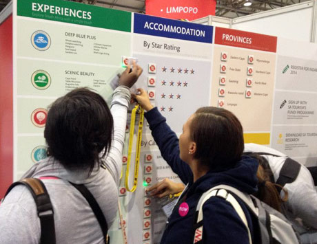 Indaba visitors scan NFC tags