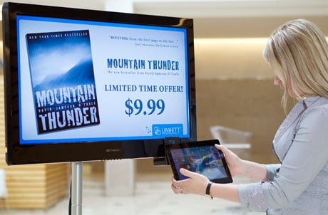 Linkett transforms an ordinary TV into an NFC-based interactive advertising display
