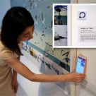 A visitor uses NFC to get information about an exhibit at the Savina Museum
