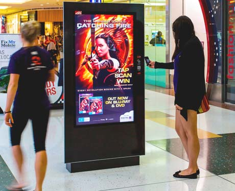 Interactive NFC DOOH panel advertising The Hunger Games Catching Fire