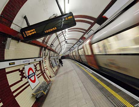 A London Underground tube train passes through a station