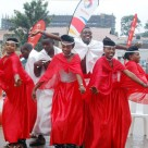 UGANDA: Dancers celebrate the launch of Airtel mobile payments at a Total gas station