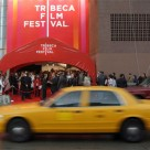 Yellow cab passing Tribeca Film Festival venue