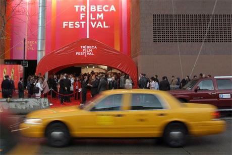 Yellow cab passing Tribeca Film Festival venue
