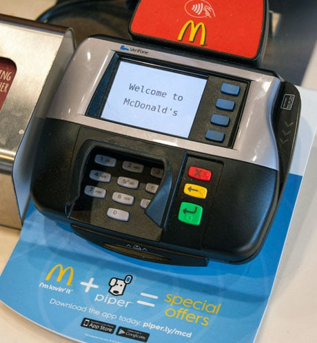 Ads on payment terminals prompt customers to download the Piper app