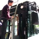 Onyx Beacon's CTO installs a Bluetooth beacon on a Bucharest trolleybus