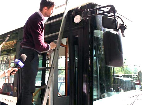 Onyx Beacon's CTO installs a Bluetooth beacon on a Bucharest trolleybus