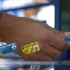 A season-ticket holder presents an NFC keycard to gain admission to the ground