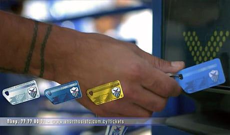 A season-ticket holder presents an NFC keycard for entryto the ground