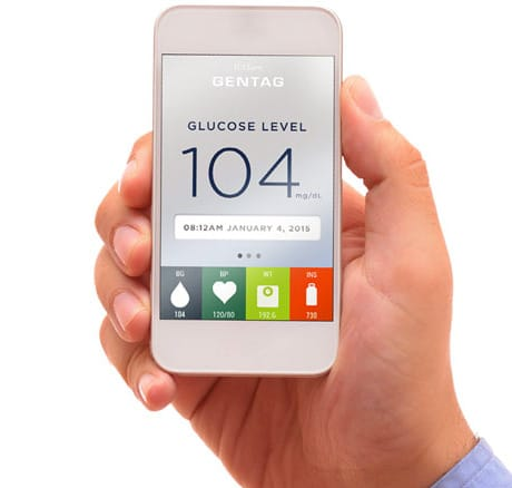 A phone shows a patient's glucose level