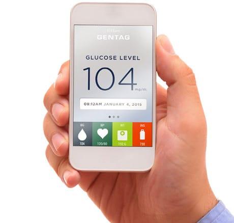 A phone shows a patient's glucose level