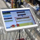 A tablet mounted on the shopping cart guides shoppers around the store