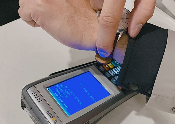 The wearer authorises contactless payments with a fingerprint scan