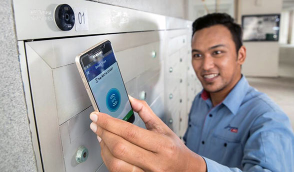 A mail carrier uses an NFC phone to record a mailbox delivery