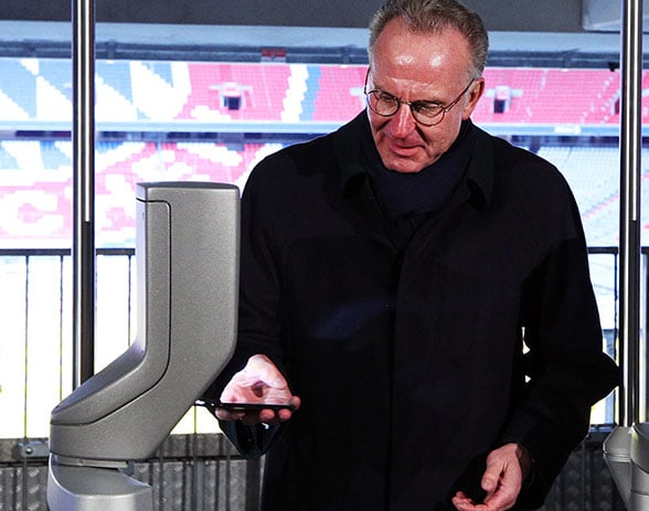 Two-time European Footballer of the Year and now Bayern Munich CEO Karl-Heinz Rummenigge tries out the NFC access gates at the Allianz Arena