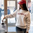 A student opens a barrier using an NFC version of Temple University's Owl card