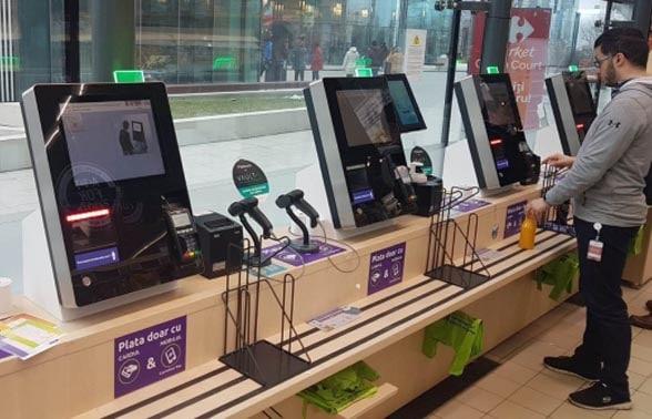 Man standing at biometric POS machines