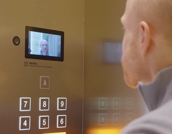 Man looking at lift screen