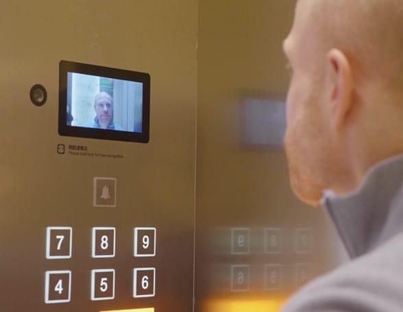 Man looking at lift screen