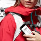 Woman in red sports gear holding smartphone