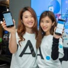 Two women holding smartphones