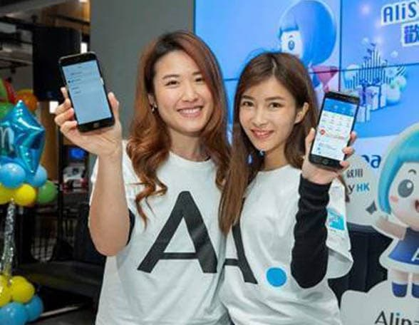 Two women holding smartphones