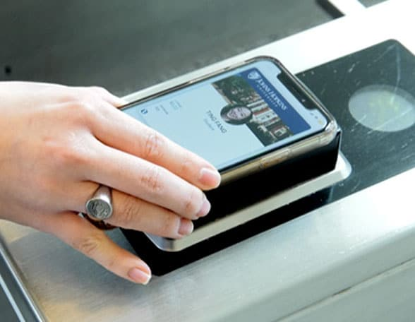 hand with smartphone scanning