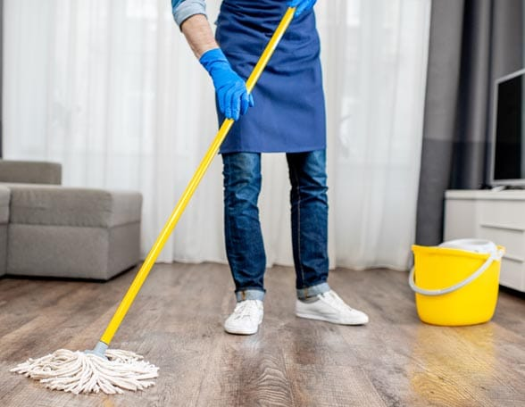Man with mop and bucket