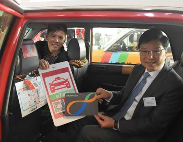 2 men sitting in a taxi
