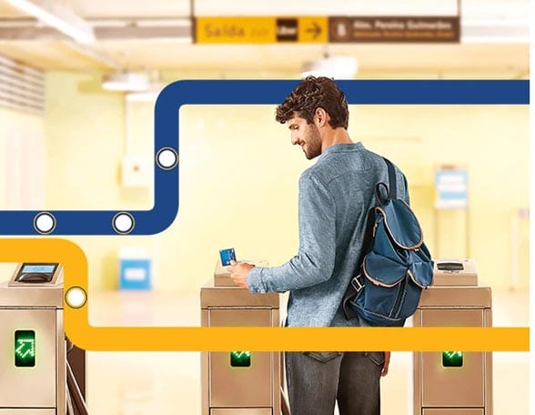Man using contactless payment on metro