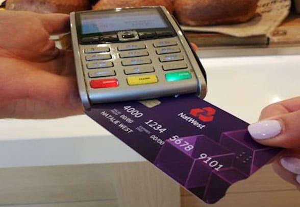Debit card being put into card reader