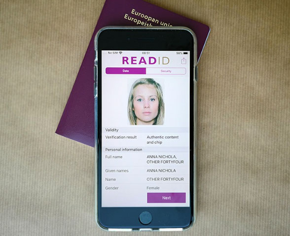 An iPhone reading a passport via NFC