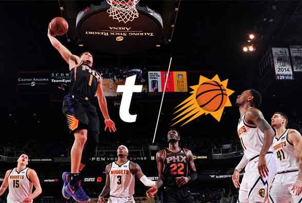 Basketball players jumping for ball
