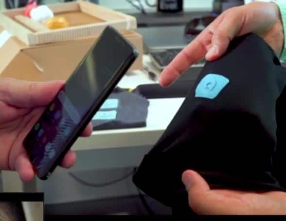 Smartphone being tapped on NFC tag on clothing