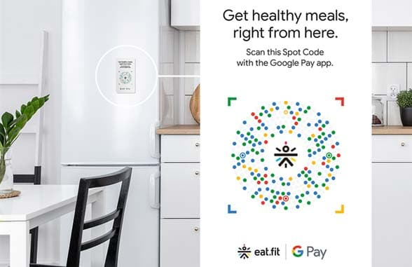 Smartphone in front of kitchen with GooglePay logo