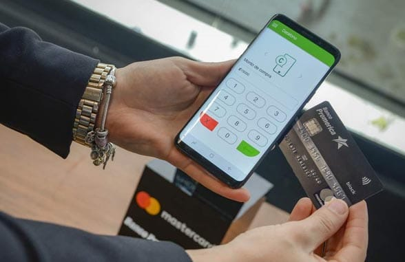 Debit card being tapped on NFC phone mPOS