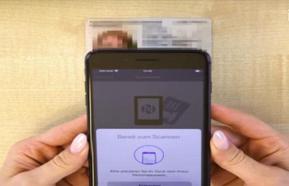 NFC smartphone screen with national ID card in background