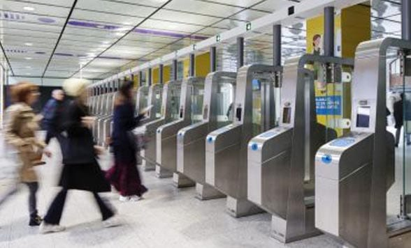 Blurred image of people entering nfc ticket barriers