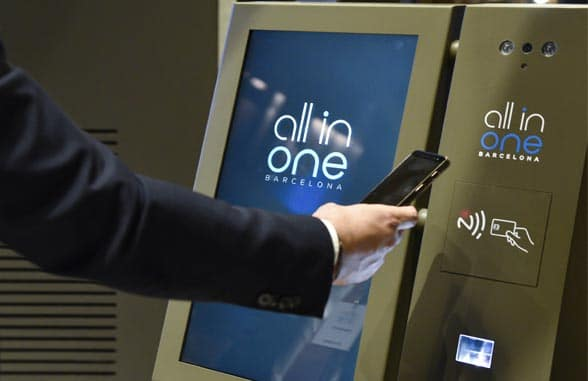 NFC smartphone being used at CaixaBank all in one terminal