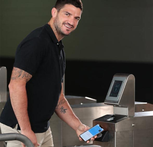 NRL star Matt Gillett using his phone for NFC ticketing