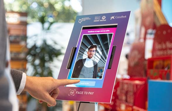 Finger pointing to Face to Pay Nestle CaixaBank Face Recognition POS